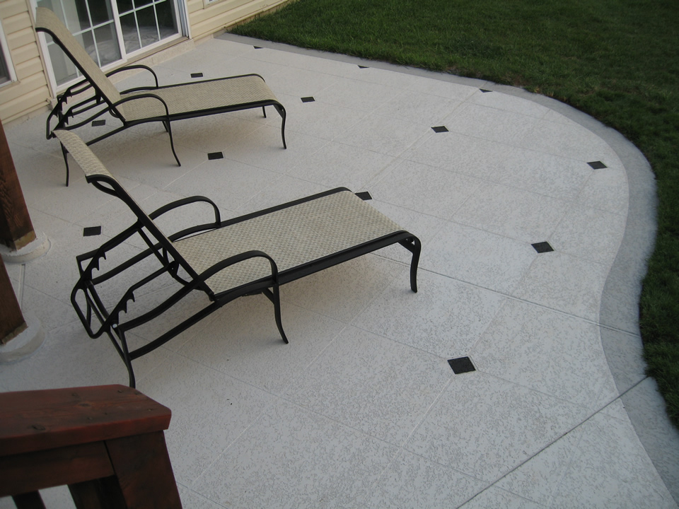 concrete patio with troweled texture